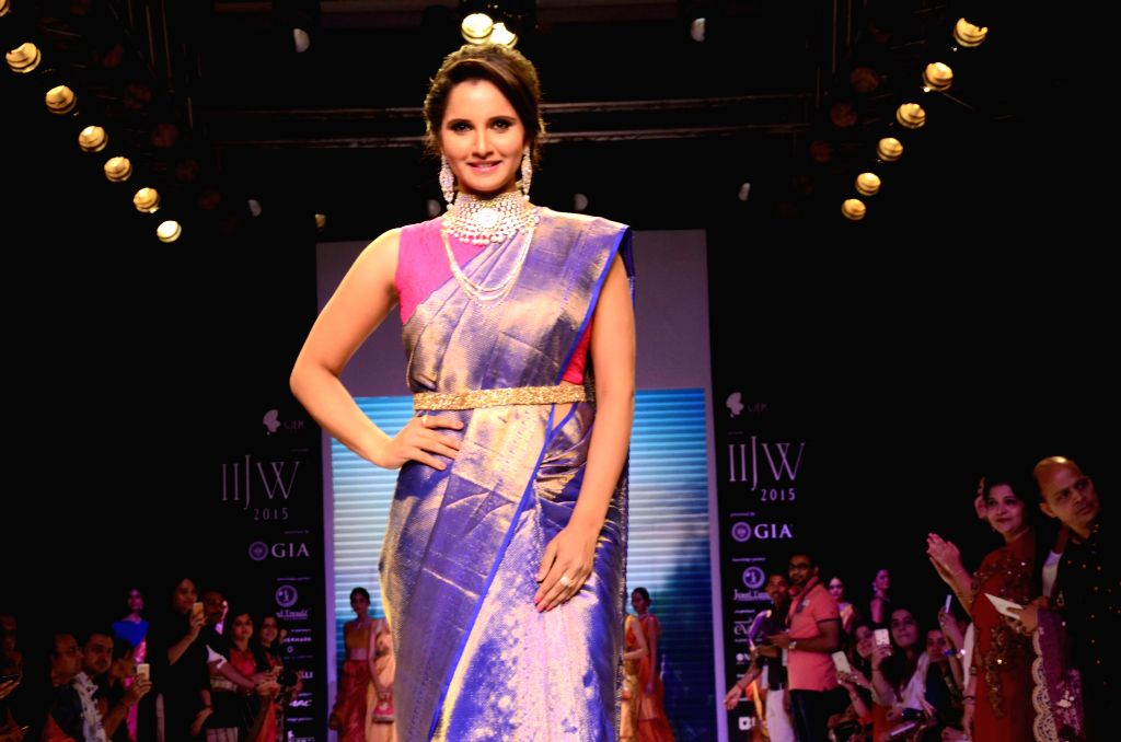 Tennis player Sania Mirza showcase creation of fashion designer Shaina NC at the India International Jewellery Week 2015, in Mumbai on Aug 3, 2015.