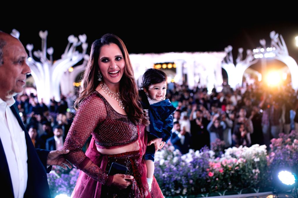 Tennis player Sania Mirza with her son Izhaan Mirza Malik at her sister Anam Mirza's wedding reception in Hyderabad on Dec 12, 2019. - Sania Mirza, Izhaan Mirza Malik and Anam Mirza
