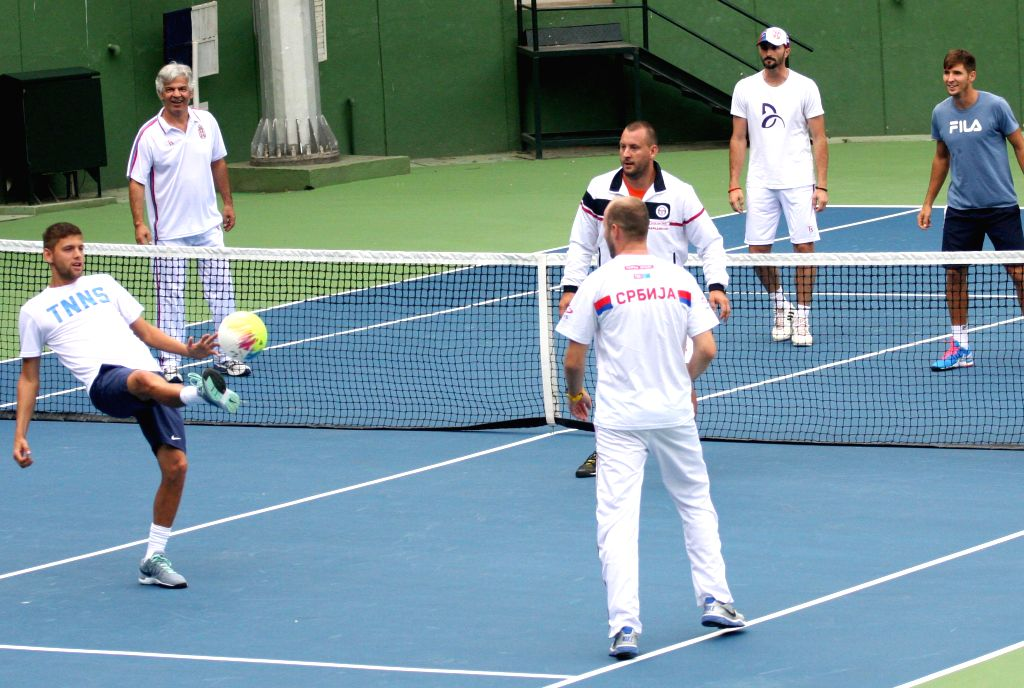 Tennis players in action during a practice session ahead of Davis Cup 2014 in Bangalore on Sept 8, 2014.
