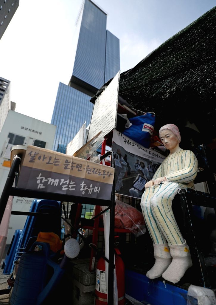 Tents for protesters remain in place in front of Samsung Electronics head office in Seoul on July 23, 2018, demanding a company apology and compensation for workers whom families and civic ...