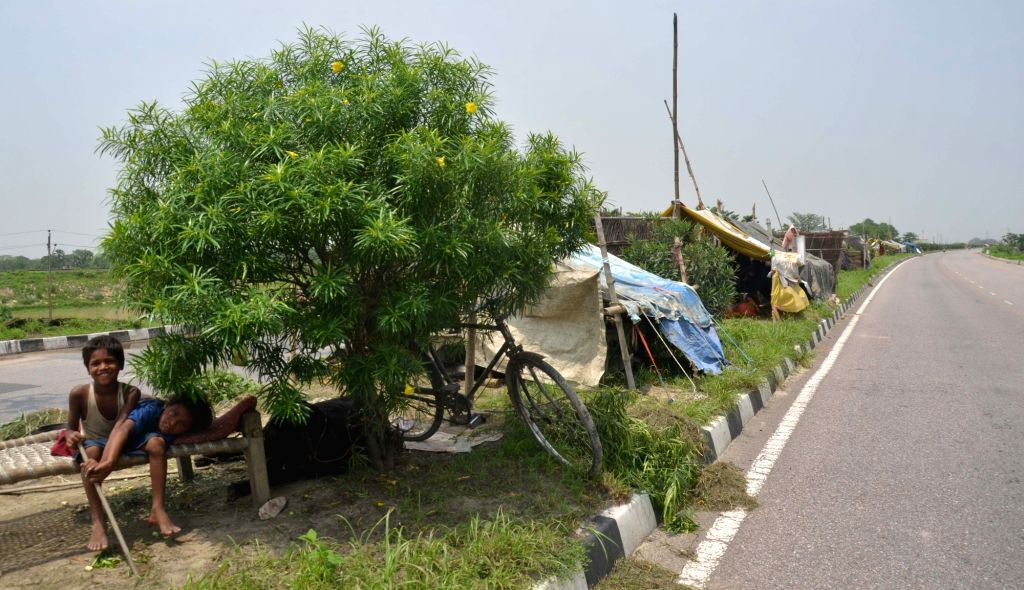 Tents installed by people from flood hit areas at on NH 77 in Muzaffarpur on July 16, 2019.