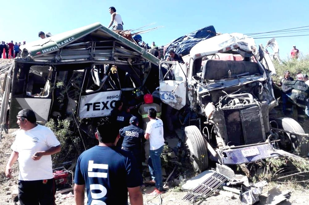 TEPETLAOXTOC, June 3, 2018 - Rescuers work at the site of an road accident in the town of Tepetlaoxtoc, in central Mexico State, Mexico, on June 2, 2018. At least 10 people were killed when a cargo ...