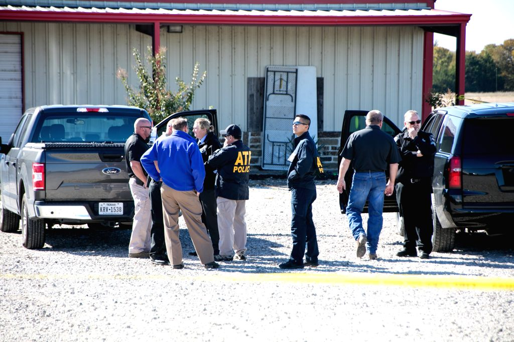 TEXAS (U.S.), Oct. 27, 2019 Police and security agents work on the scene of a shooting incident in Greenville, Texas, the United States, on Oct. 27, 2019. Two people were killed and about ...