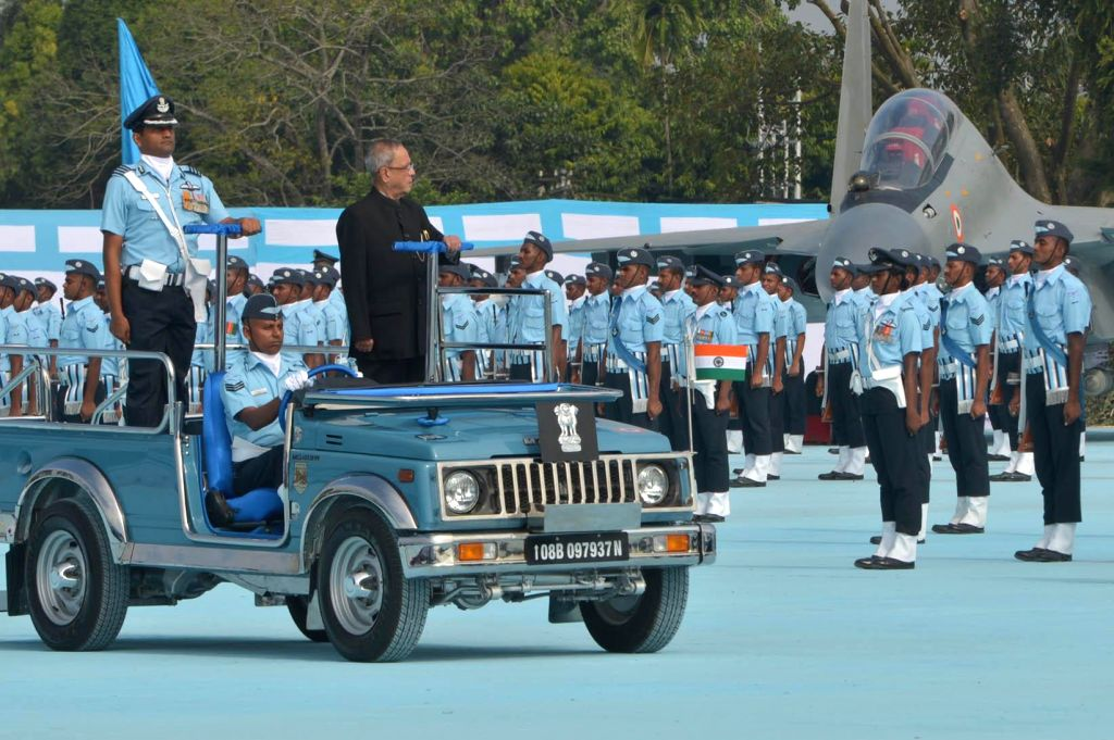 President Pranab Mukherjee inspects guard of honour during a programme organised to present President's standards to the 115 HU and the 26 Squadron of Indian Air Force in Tezpur, Assam  on ... - Pranab Mukherjee