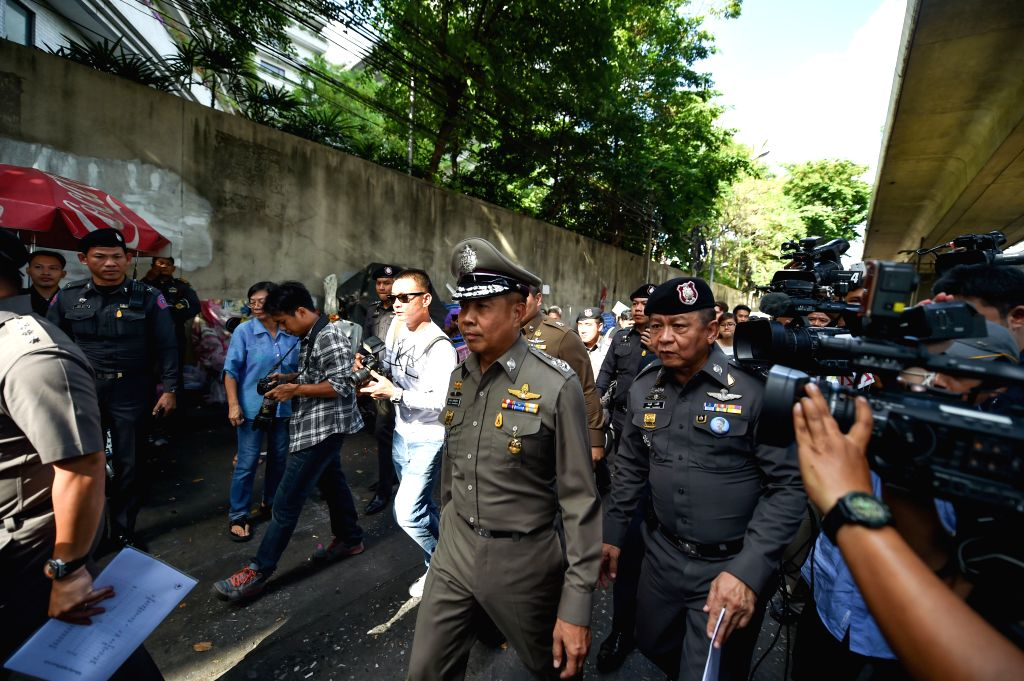 Thai national police chief Somyot Poompanmoung (C) arrives at the explosion site at a wharf of the Chao Phraya river in Bangkok, Thailand, on Aug. 18, 2015. No ...
