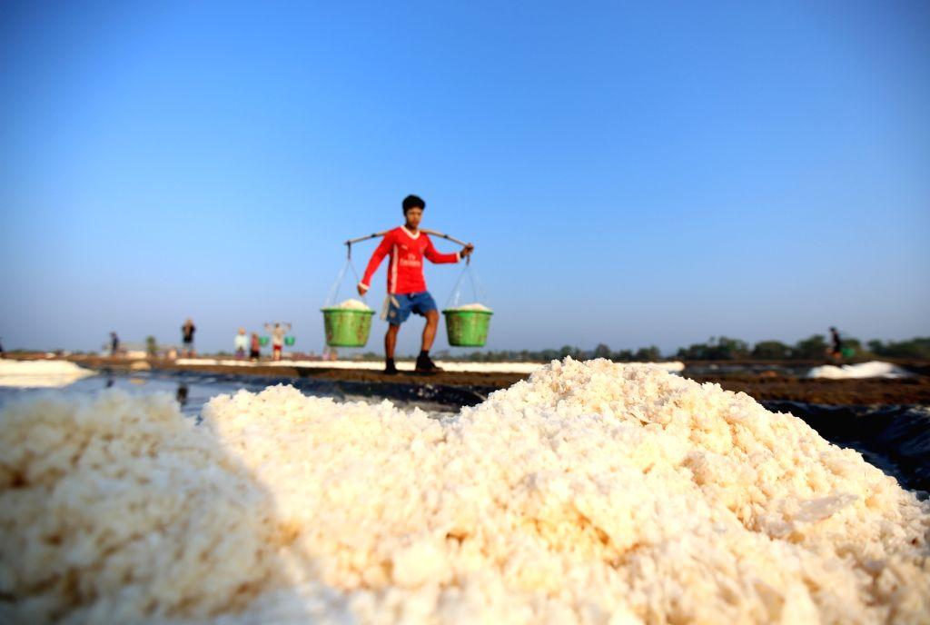 THANBYUZAYAT, March 2, 2019 - A farmer works in salt beds at Pa-nga Village, Thanbyuzayat Township, Mon State, Myanmar, March 2, 2019.