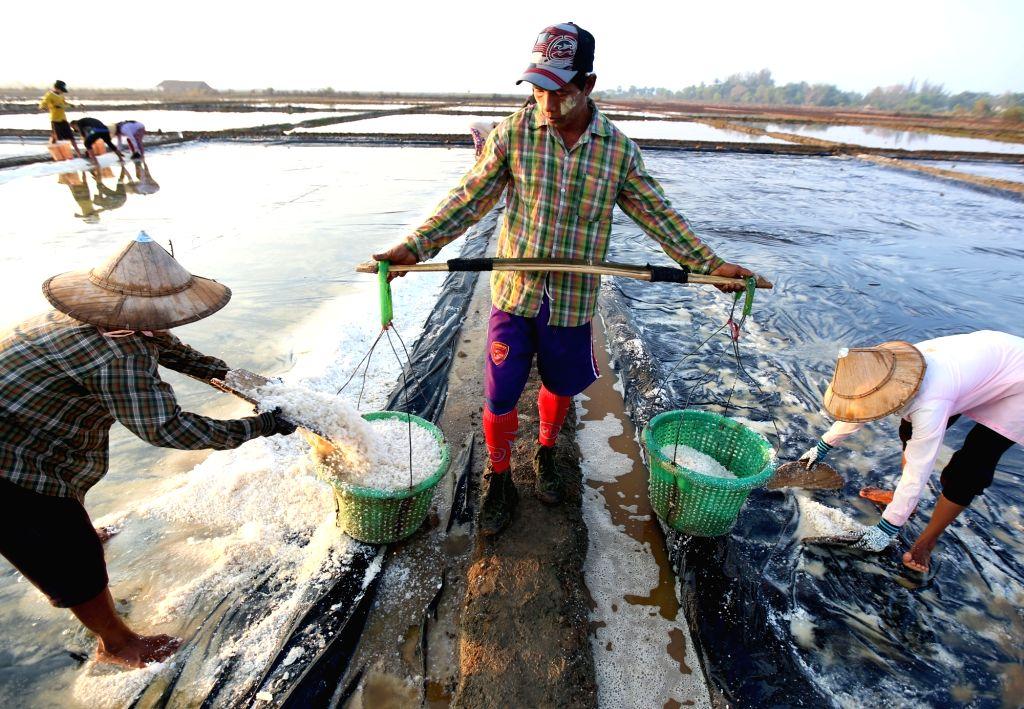 THANBYUZAYAT, March 2, 2019 - Farmers work in salt beds at Pa-nga Village, Thanbyuzayat Township, Mon State, Myanmar, March 2, 2019.