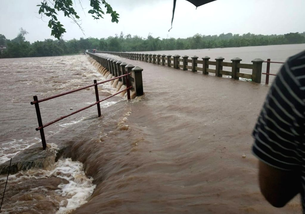 Thane: A view of Bhatsa Dam seen overflowing after a heavy monsoon rains on Bhatsa river near Shahapur in Maharashtra's Thane district on Aug 4, 2019. (Photo: IANS)