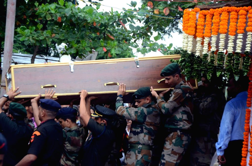 :Thane: The mortal remains of Major Kaustubh P. Rane being taken for his last rights, in Maharashtra's Thane on Aug 9, 2018. Thousands of people, including grieving family members, bid a ...