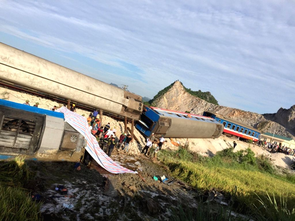 THANH HOA, May 24, 2018 - People stand at the site of a train-truck accident in Thanh Hoa Province, central Vietnam, May 24, 2018. A train hit a stone-carrying truck in Thanh Hoa early Thursday, ...
