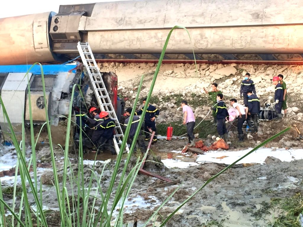 THANH HOA, May 24, 2018 - Rescuers work at the site of a train-truck accident in Thanh Hoa Province, central Vietnam, May 24, 2018. A train hit a stone-carrying truck in Thanh Hoa early Thursday, ...