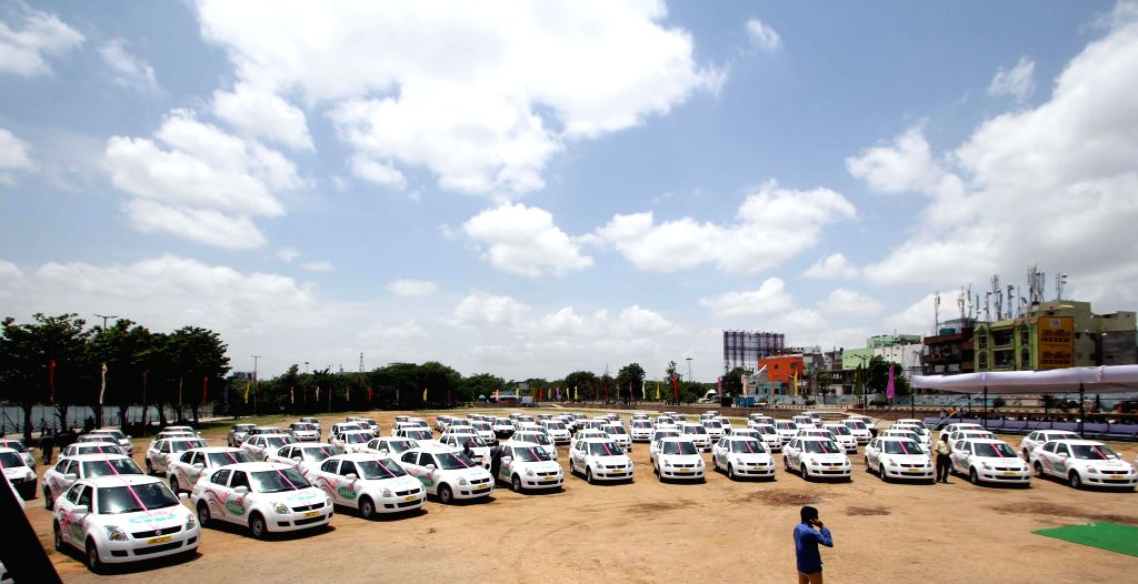 The 105 cars distributed to the unemployed youths under `Driver-cum-owner`scheme by Telangana Deputy Chief Minister Mahmood Ali during a programme at Necklace Road of Hyderabad on Aug 13, 2014. - Mahmood Ali
