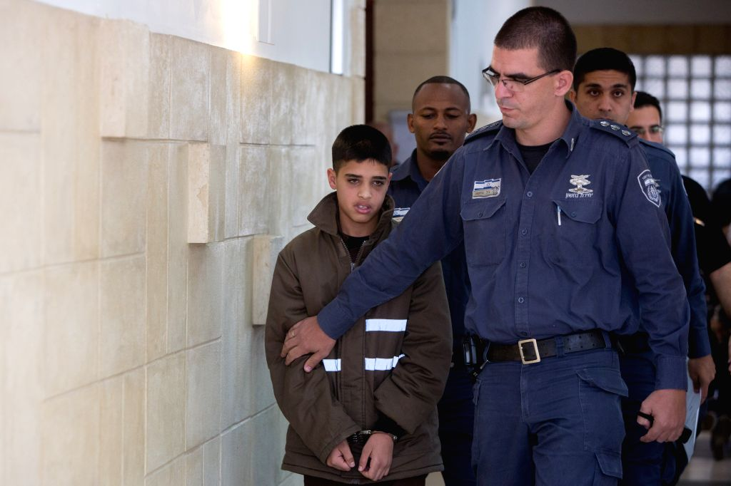 The 13-year-old Palestinian Ahmed Manasra (1st L) is seen at the district court in Jerusalem, on Oct. 30, 2015. Ahmed Manasra who took part in a stabbing attack ...