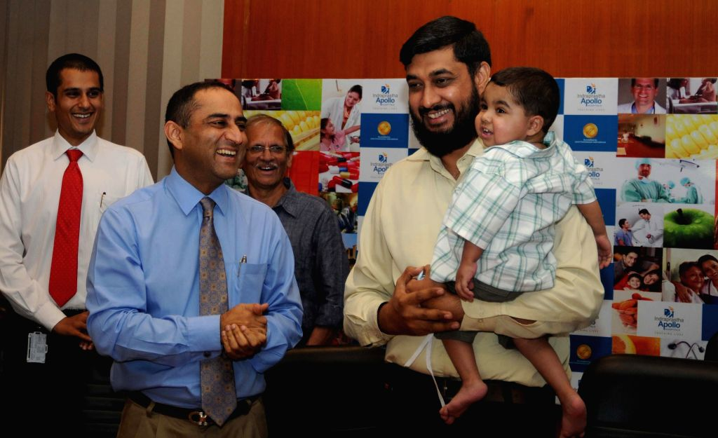 The 500th Pakistani patient to be treated by a private hospital, two-yr-old Nalain Aziz with his father during a press conference in New Delhi on April 23, 2014.