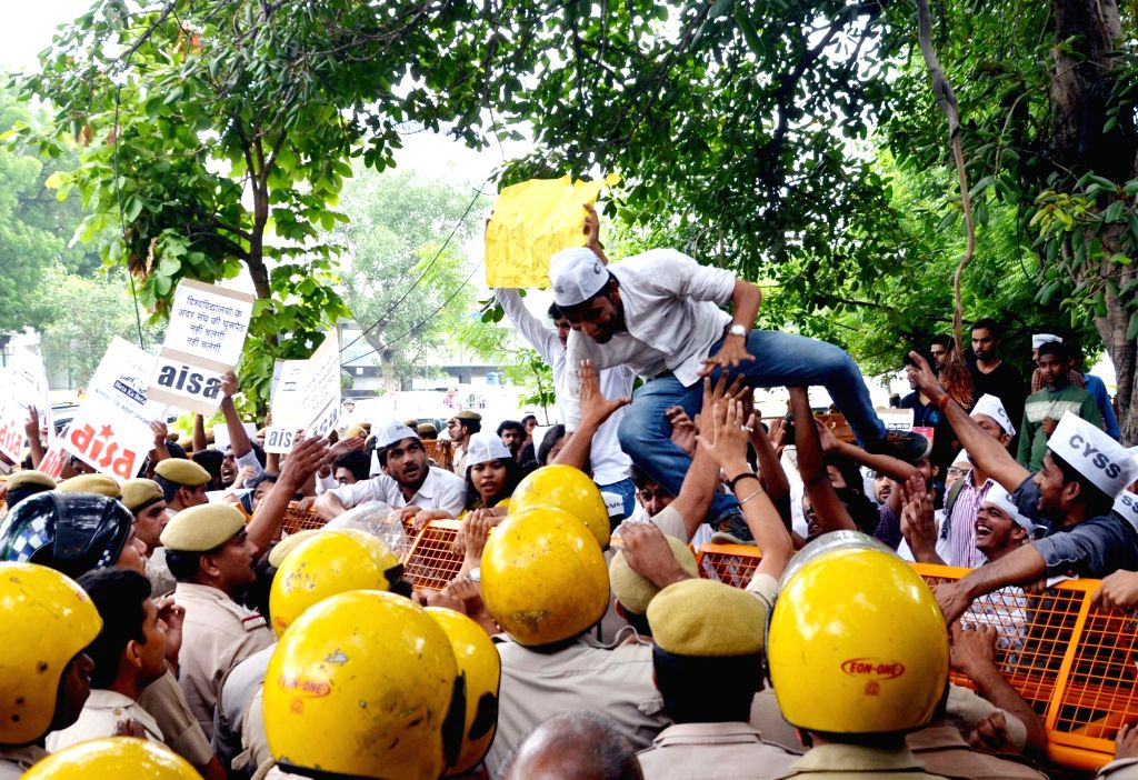 The activists of Chhatra Yuva Sangharsh Samiti (CYSS) and All India Students' Association (AISA) stage a demonstration against Delhi Police for not filling a FIR against the son of BJP MP ...