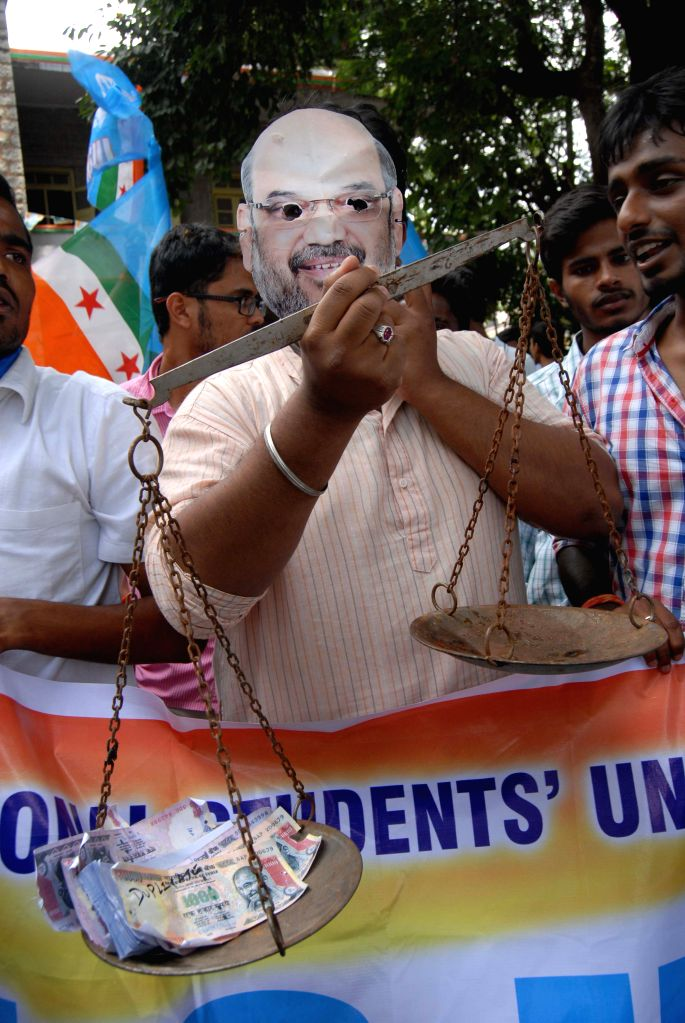 The activists of NSUI stage a demonstration against BJP chief Amit Shah over inaction against corrupt party leaders despite several allegations against them, in Bengaluru on July 5, 2015.