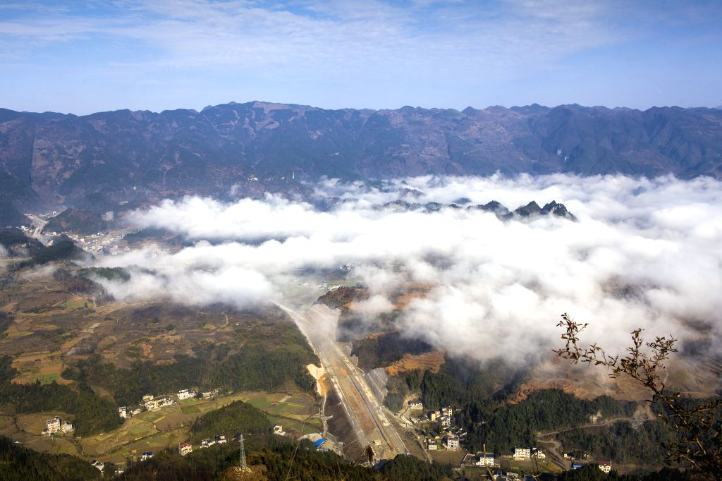 The aerial photo taken on Jan. 18, 2016 shows the scenery of villages in Longshan County,central China's Hunan Province. (Xinhua/Zeng Xianghui)