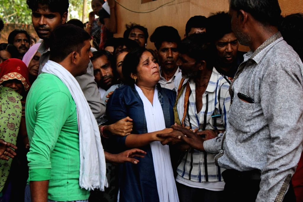 The aggrieved relatives of the residents of the house, the roof of which collapsed at Dwarka's Hari Vihar area in New Delhi on July 23, 2018. Two members of a family were killed and three ...