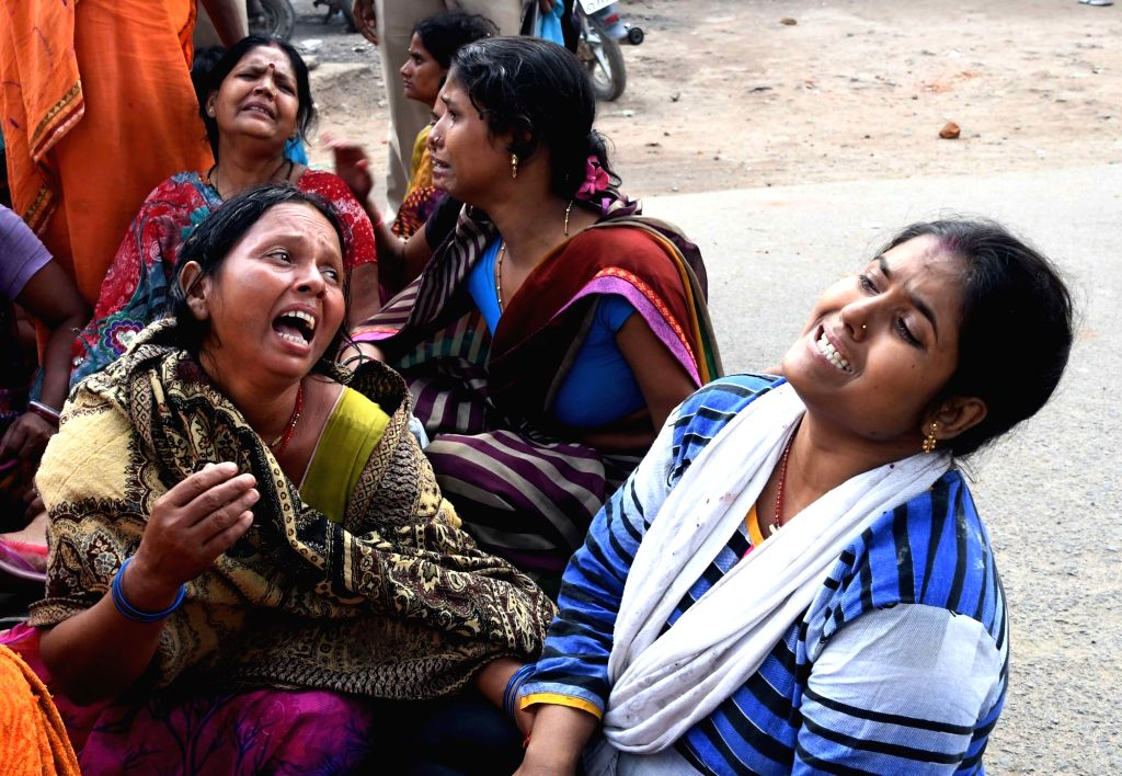 The aggrieved relatives of the those who were killed and injured after police opened fire during a violent clash with a group of people in a dispute over gambling, in Patna on Nov 5, 2018. ...