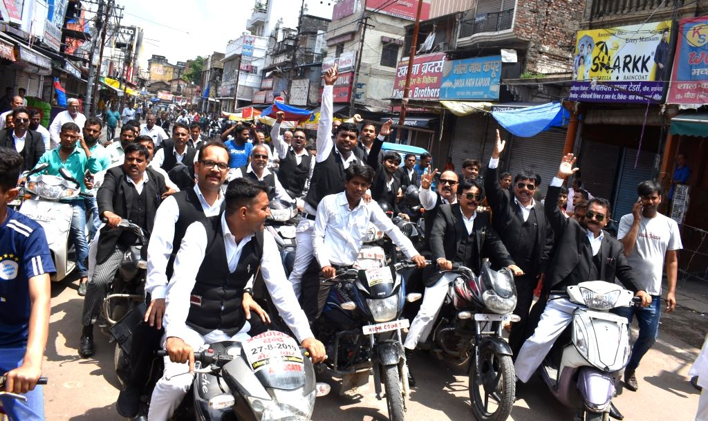 The Allahabad High Court lawyers take out a motorcycle rally against shifting of various government offices and tribunals from here to Lucknow; in Prayagraj on Aug 27, 2018.