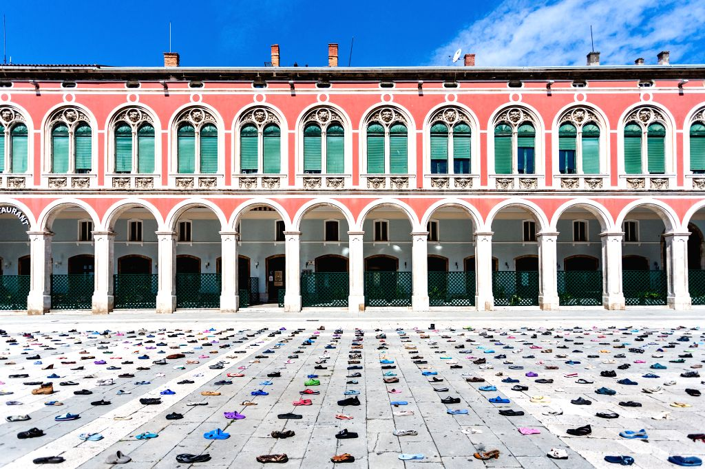 "The art installation ""1000 Cinderellas"", which consists of 1,000 shoes laid out by artist Mark Boellaard, is displayed on Prokurative Square in Split, ... - Mark Boellaard"