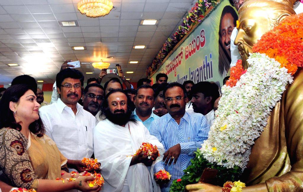 The Art of Living founder Sri Sri Ravishankar pays floral tribute to Tiruvallur statue on the occasion of Tiruvallur Jayanti celebrations, in Bengaluru, on Jan 16, 2016.