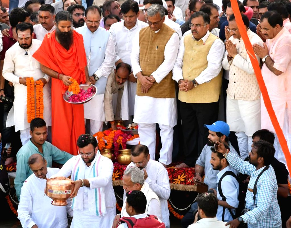 The ashes of late Finance Minister and senior BJP leader Arun Jaitley were immersed in the Ganga in Haridwar by his son Rohan Jaitley on Aug 26, 2019. Also seen Uttarakhand Chief Minister ... - Trivendra Singh Rawat, Arun Jaitley and Rohan Jaitley
