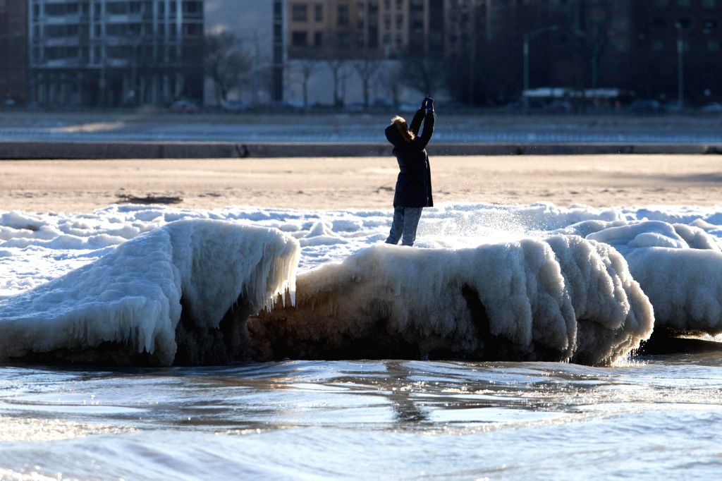 The bank of Lake Michigan is frozen as chill weather continues in Chicago, the United States, Jan, 18, 2016.