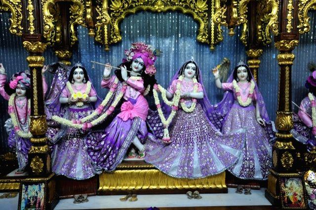 The beautifully decorated idols of Lord Krishna, his consort Radharani and gopis dressed up in the Night dress during Krishna Janmashtami celebrations at the Radha Gopinath Temple, ISKCON ...