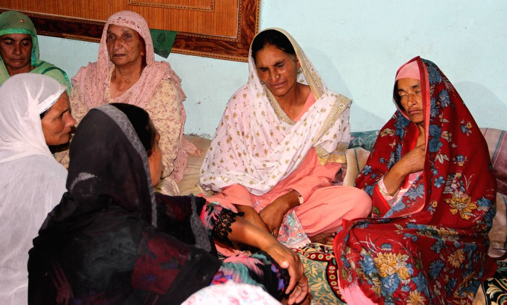 The bereaved family of  Sarpanch Karamat Hussain, who was killed in cross border firing in Poonch district of Jammu and Kashmir; on Aug 17, 2015.