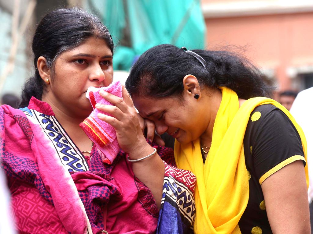 The bereaved relatives of the victims who were killed when a three-storey building collapsed in Thane, Maharashtra, on Aug 4, 2015. Atleast 11 persons died and five people have been rescued, ...