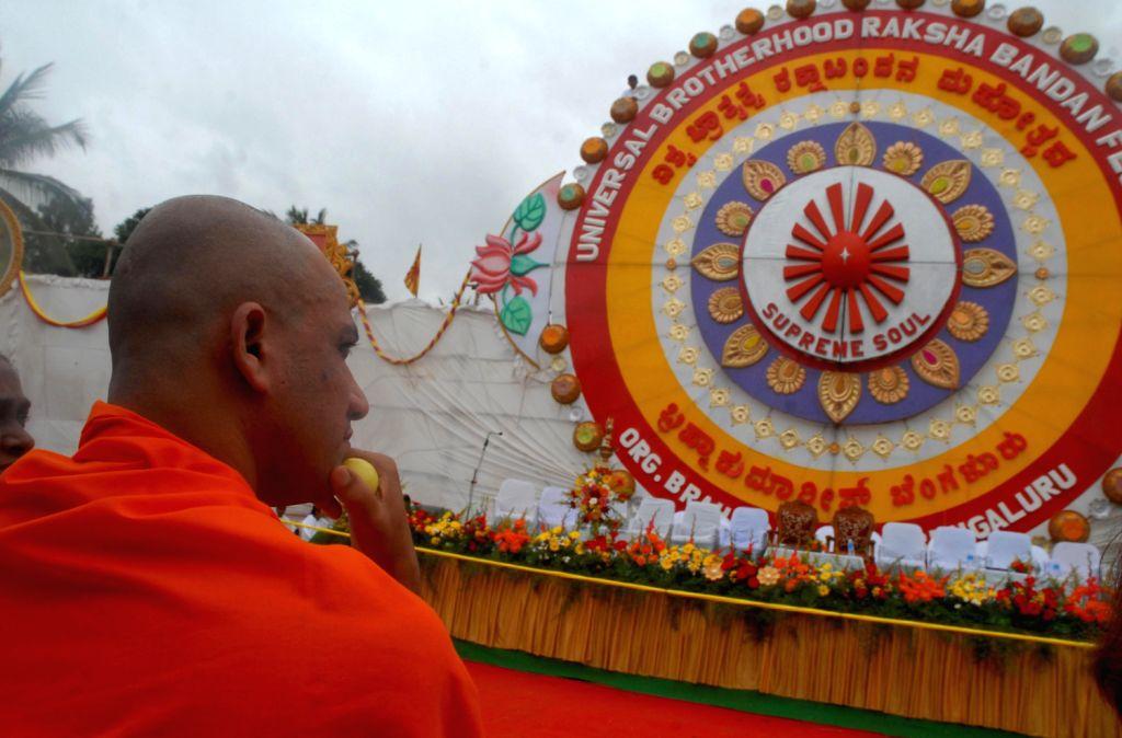 The Biggest Rakhi attracts people during Universal Brotherhood Raksha Bandhan Festival 2013 organised by Brahma Kumaris at Udaya Bhanu Play Grounds on Bull Temple road in Bangalore on August 17, ...