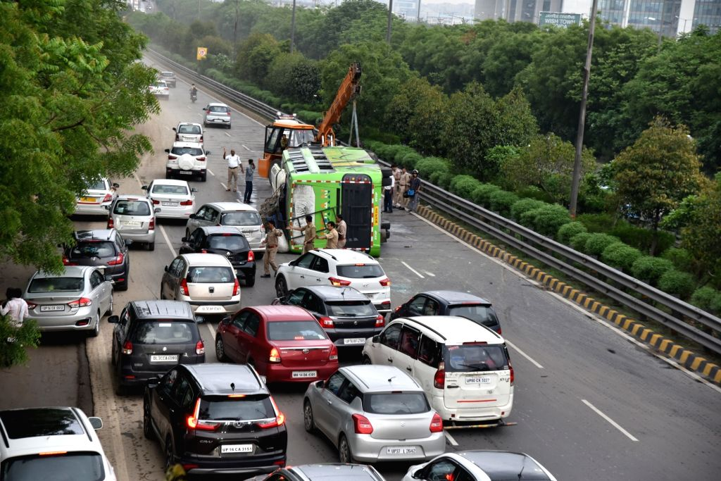 The Bihar-bound passenger bus that overturned after hitting the divider at the Noida-Greater Noida Expressway, being towed away on July 26, 2019. The accident left 12 injured.