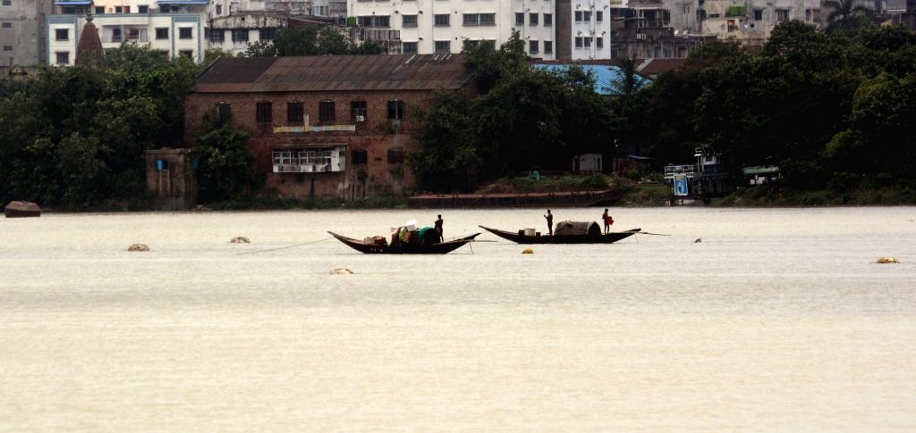 The boat is moving in the Ganges in the rain during the lockdown on Coronavirus pandemic in Kolkata on Tuesday June 15, 2021.