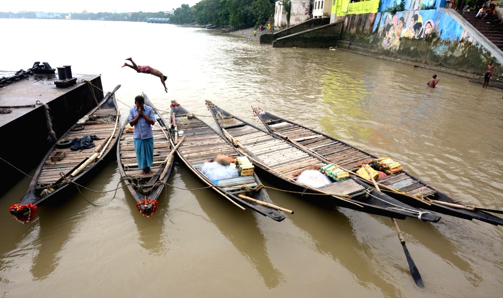The boatmen are worshiping the boat at the Ganges ghat during the Goddess Manasha Puja festival at River Ganga in Kolkata on Sunday, June 20, 2021.