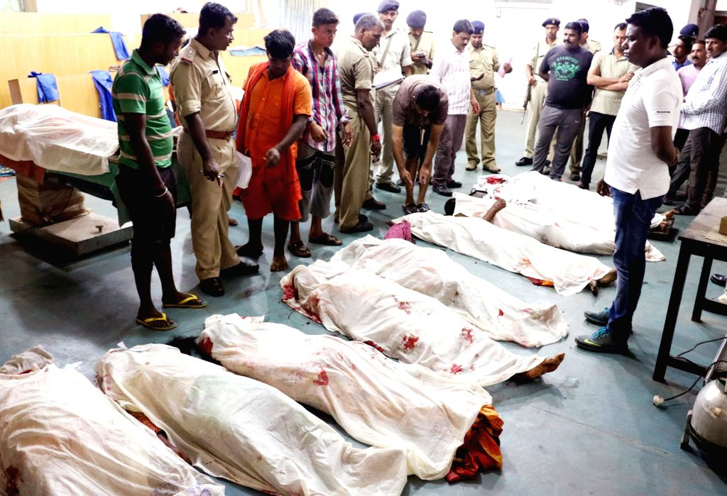 The bodies of kanwarias -pligrims- who were killed in a road accident in Ichagarh of Jharkhand's Seraikela Kharsawan district lies at a morgue on Aug 14, 2015. At least 13 pilgrims were ...