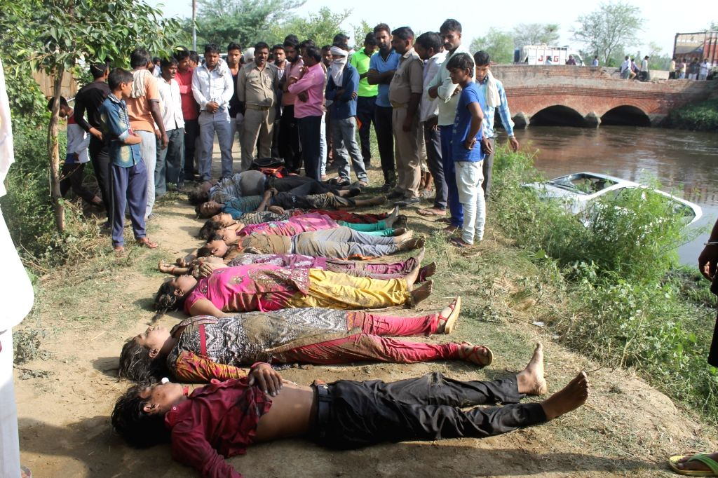 The bodies of the ten people, including nine members of a family who were killed after the car they were travelling in fell into a canal at the Mathura-Jajampatti road on June 11, 2017. The ...