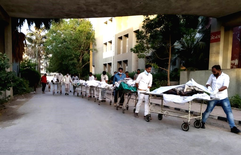 The bodies of the victims who were killed after a massive fire broke out at a coaching centre atop a four-storey building, in Sarthana area of Gujarat's Surat arrive at SMIMER hospital, in ...