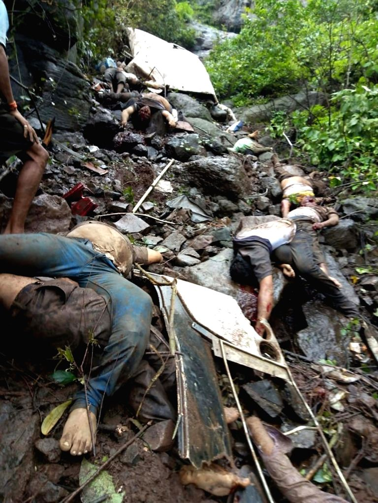 The bodies of those killed when a private bus on a picnic trip plunged into a deep ravine near Poladpur in Maharashtra's Raigad on July 28, 2018. At least 32 university staffers were killed ...