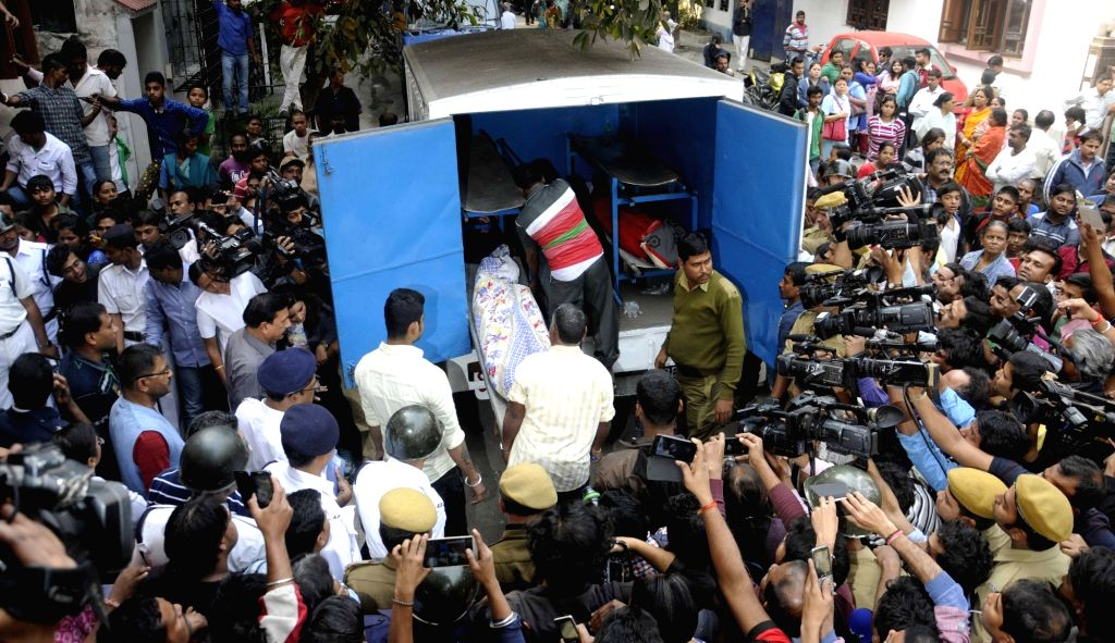The bodies of three members of a family being taken away, suspected to have been murdered, were found inside an apartment in Kolkata`s Palm Avenue area, on Jan 16, 2016.