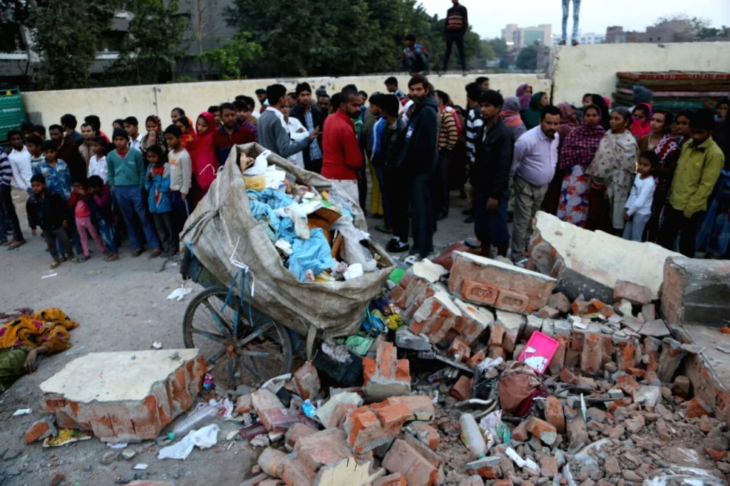 The body of 30-year-old rag-picker Marjina who died while her husband Ansar Ali and minor son injured after a loader, which was lifting the garbage nearby, suddenly hit the wall of a ...