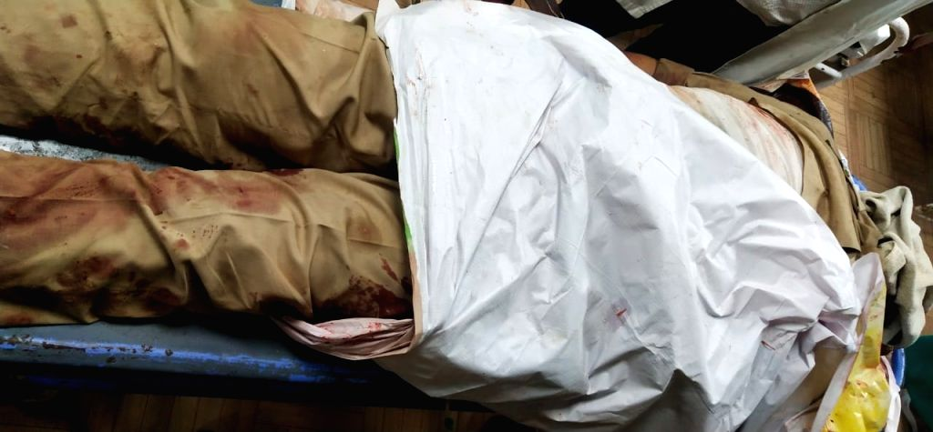 The body of one of the police personnel who was killed after a gangster along with his gang sprayed bullets in Vikru village under Chaubeypur police circle in Kanpur on July 3, 2020. Eight ...
