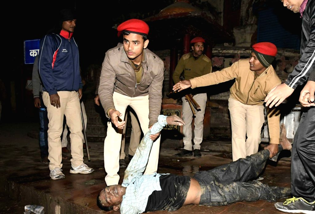 The body of one of the victims of boat accident after being fished out of the Ganga river in Patna on Jan 14, 2017. At least 17 passengers were killed and many others were missing as a boat ...