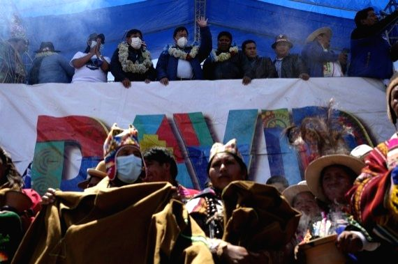 The Bolivian president-elect, Luis Arce Catacora (C, above), greets his supporters during a celebration of the Movement Towards Socialism (MAS) party for the results in the general elections, in El ...