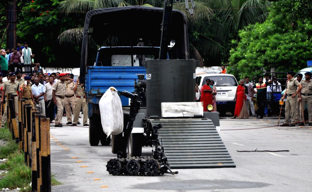 The bomb disposal squad at the site where a suspicious object was recovered by the police in the parking zone of Guwahati railway station on Aug 18, 2017.
