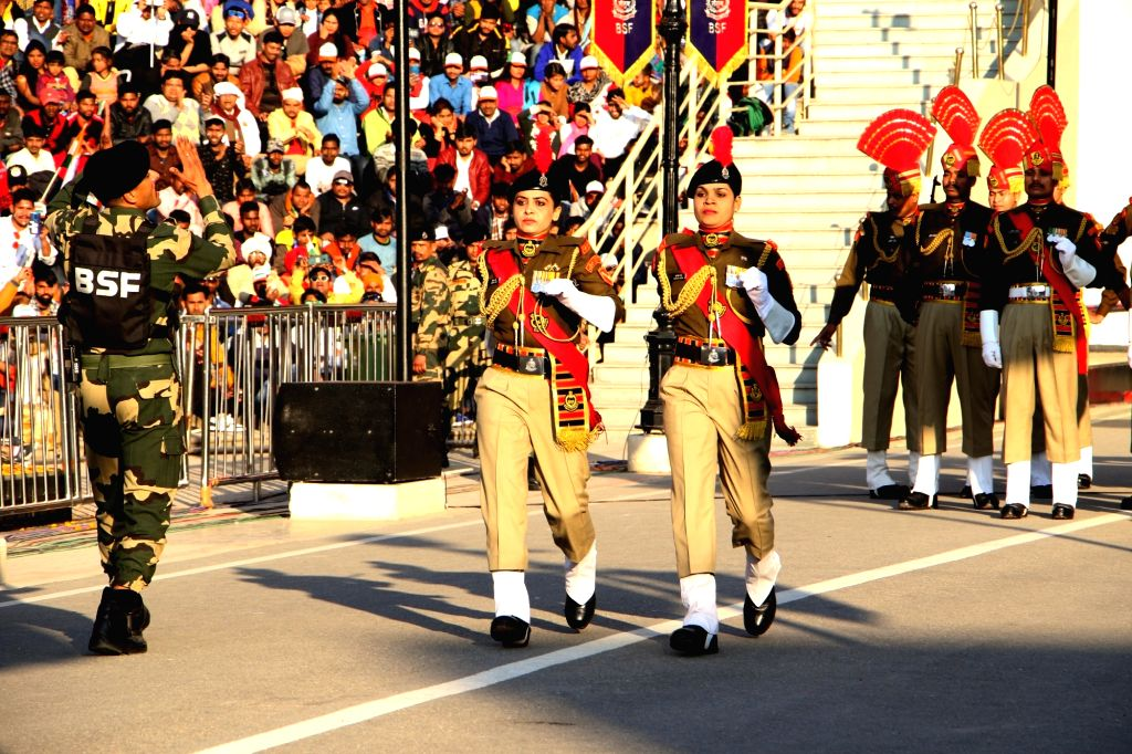 The Border Security Force personnel during the Beating Retreat ceremony at 71st Republic Day celebrations at the India-Pakistan border post at Attari, about 35 kms from Amritsar on Jan 26, ...