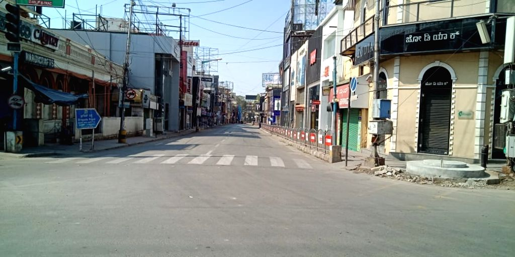 The Brigade Road bears a deserted look during the nationwide 'Janata Curfew' imposed to contain the spread of COVID-19 (coronavirus), in Bengauru on March 22, 2020.