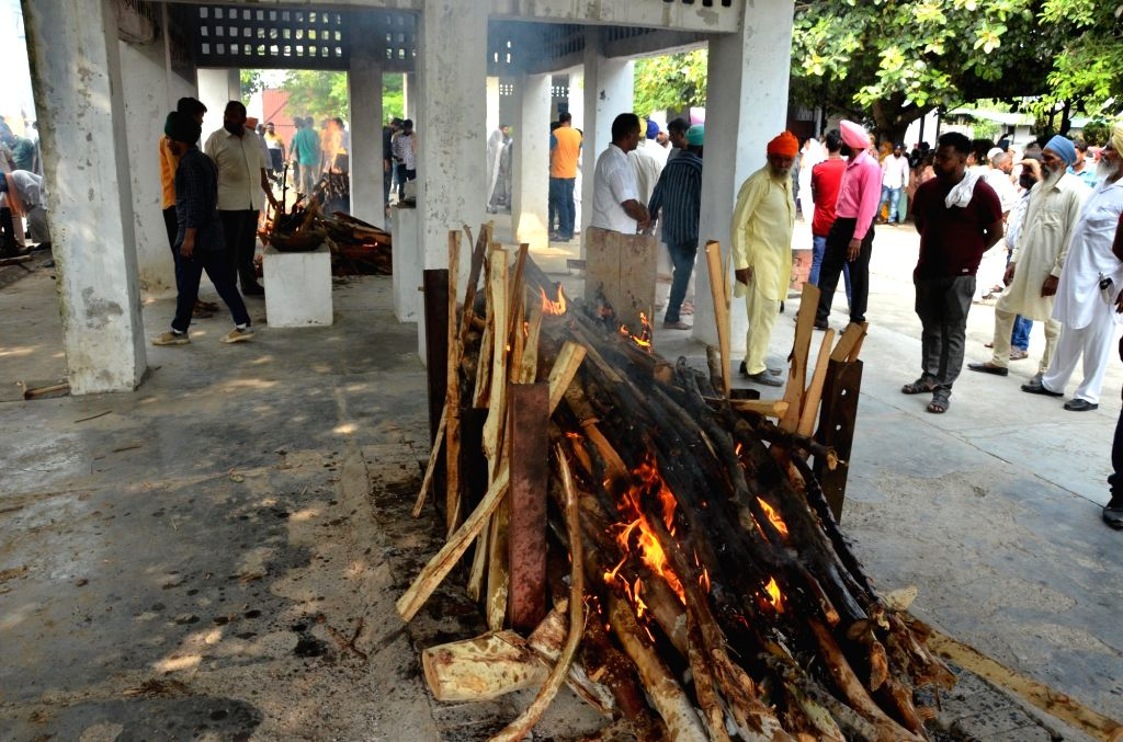 The burning pyre of a Gurdaspur factory fire victim at the funeral rites at Batala in Punjab's Gurdaspur, on Sep 5, 2019. At least 21 people were killed and 26 injured in an explosion ...