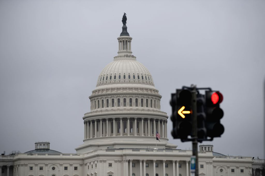 The Capitol and traffic lights are seen in Washington D.C., the United States, on Feb. 5, 2020. U.S. President Donald Trump was acquitted on Wednesday by the ...