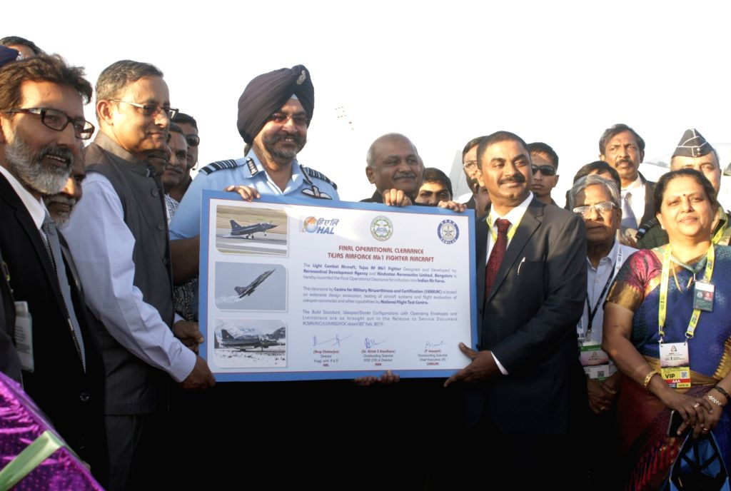 The Centre for Military Airworthiness and Certification (Cemilac) Chief Executive P. Jayapal hands over the 'release-to-service' documents to the Chief of Air Staff Air Marshal B.S. Dhanoa ...